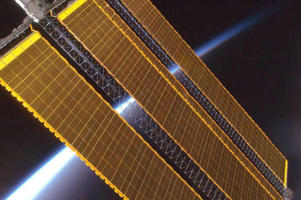 The solar arrays of the International Space Station. Image Source: NASA via Wikimedia commons. Public Domain.